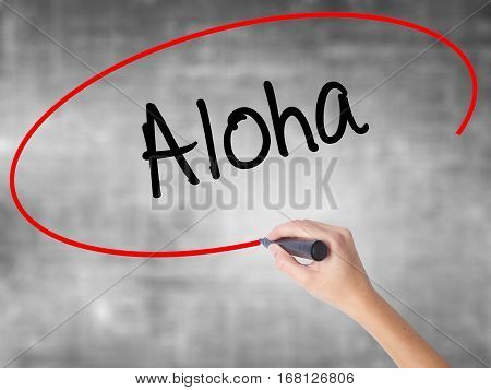 Woman Hand Writing Aloha  With Black Marker Over Transparent Board