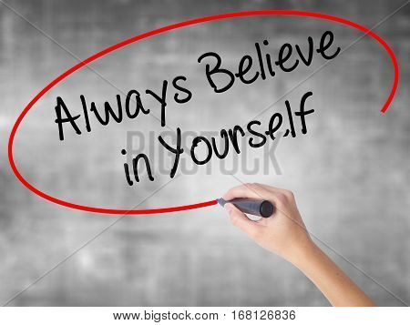 Woman Hand Writing Always Believe In Yourself With Black Marker Over Transparent Board
