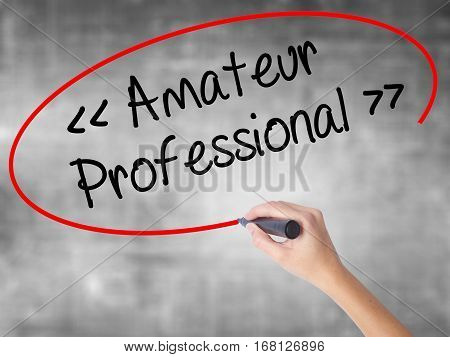Woman Hand Writing Amateur - Professional With Black Marker Over Transparent Board.