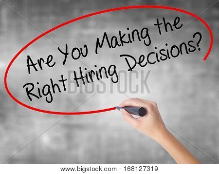 Woman Hand Writing Are You Making The Right Hiring Decisions? With Black Marker Over Transparent Boa