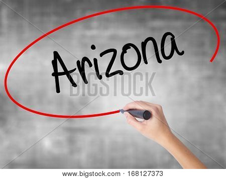 Woman Hand Writing  Arizona  With Black Marker Over Transparent Board
