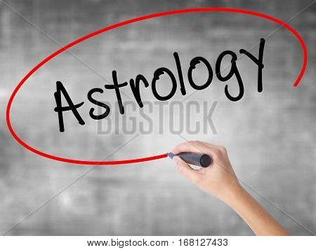 Woman Hand Writing Astrology With Black Marker Over Transparent Board