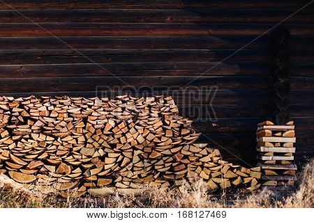 Stacked firewood. Firewood stacked near the fence