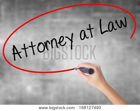 Woman Hand Writing Attorney At Law With Black Marker Over Transparent Board.