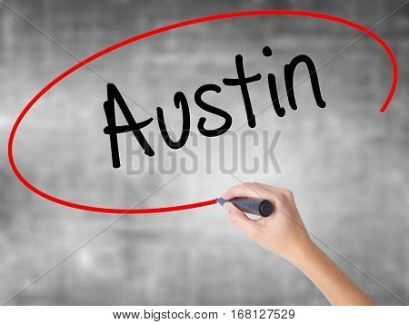 Woman Hand Writing Austin  With Black Marker Over Transparent Board