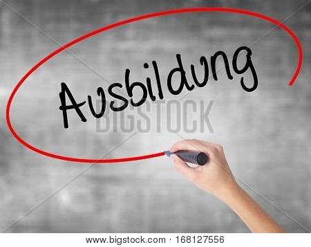 Woman Hand Writing Ausbildung (education In German) With Black Marker Over Transparent Board