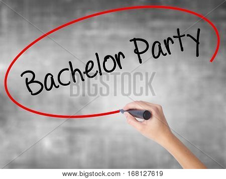 Woman Hand Writing Bachelor Party With Black Marker Over Transparent Board