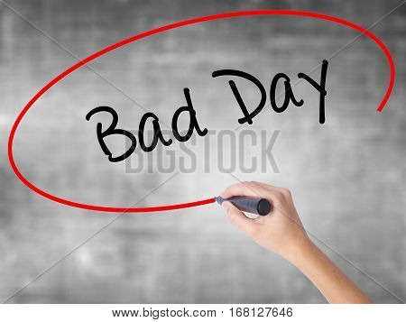 Woman Hand Writing Bad Day  With Black Marker Over Transparent Board