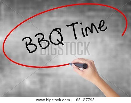 Woman Hand Writing Bbq Time With Black Marker Over Transparent Board