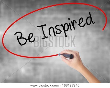 Woman Hand Writing Be Inspired With Black Marker Over Transparent Board