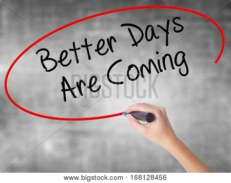 Woman Hand Writing Better Days Are Coming With Black Marker Over Transparent Board.