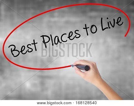 Woman Hand Writing Best Places To Live With Black Marker Over Transparent Board