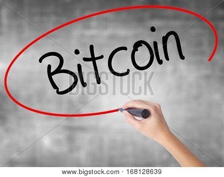 Woman Hand Writing Bitcoin With Black Marker Over Transparent Board.