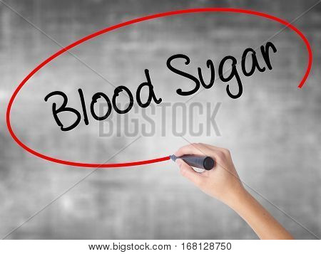 Woman Hand Writing Blood Sugar With Black Marker Over Transparent Board