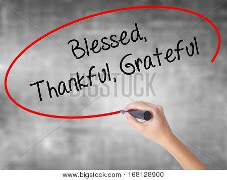 Woman Hand Writing  Blessed Thankful Grateful With Black Marker Over Transparent Board