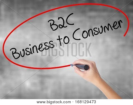 Woman Hand Writing B2C Business To Consumer With Black Marker Over Transparent Board