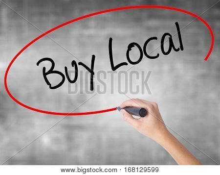 Woman Hand Writing Buy Local  With Black Marker Over Transparent Board