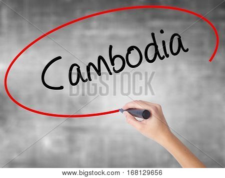 Woman Hand Writing Cambodia  With Black Marker Over Transparent Board