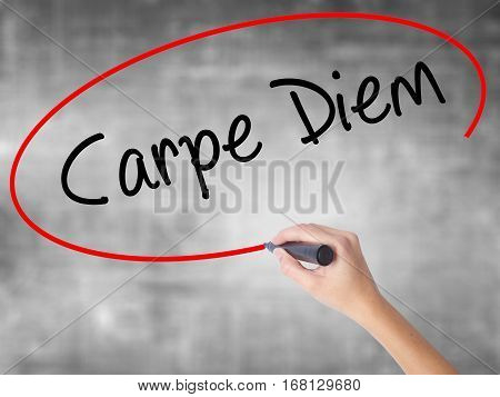 Woman Hand Writing Carpe Diem With Black Marker Over Transparent Board
