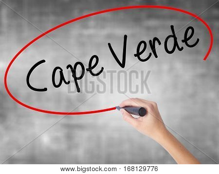 Woman Hand Writing Cape Verde With Black Marker Over Transparent Board
