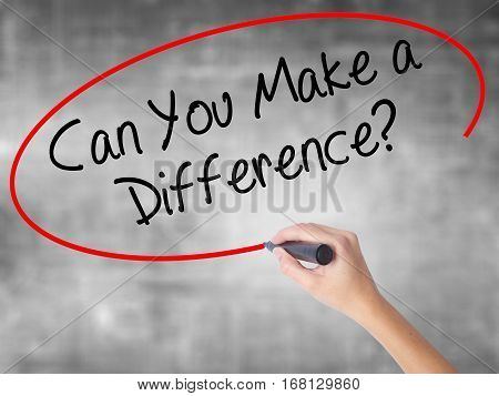 Woman Hand Writing Can You Make A Difference? With Black Marker Over Transparent Board.