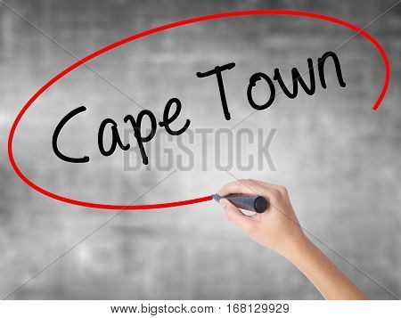 Woman Hand Writing Cape Town With Black Marker Over Transparent Board