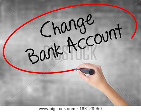 Woman Hand Writing Change Bank Account With Black Marker Over Transparent Board