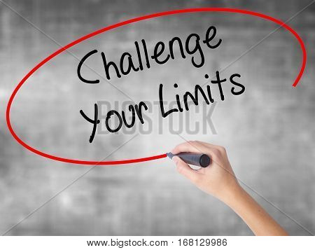 Woman Hand Writing Challenge Your Limits With Black Marker Over Transparent Board
