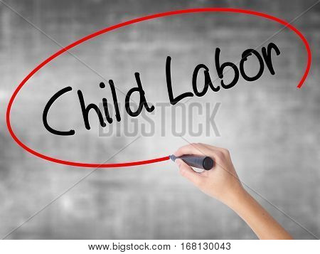 Woman Hand Writing Child Labor With Black Marker Over Transparent Board