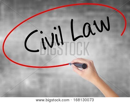 Woman Hand Writing Civil Law With Black Marker Over Transparent Board