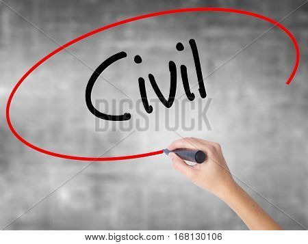 Woman Hand Writing Civil With Black Marker Over Transparent Board