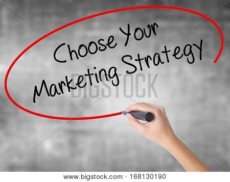 Woman Hand Writing Choose Your Marketing Strategy With Black Marker Over Transparent Board