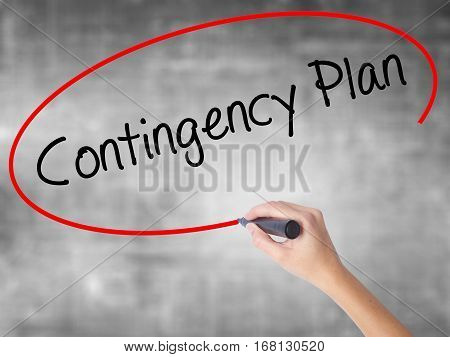 Woman Hand Writing Contingency Plan With Black Marker Over Transparent Board.