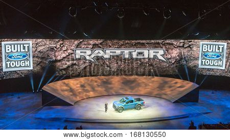 DETROIT MI/USA - JANUARY 12 2015: Ford F-150 SVT Raptor reveal at the North American International Auto Show (NAIAS) one of the most influential car shows in the world each year.