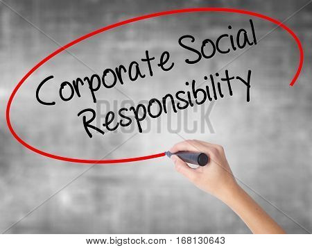 Woman Hand Writing Corporate Social Responsibility With Black Marker Over Transparent Board.