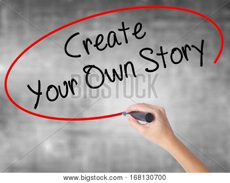 Woman Hand Writing Create Your Own Story With Black Marker Over Transparent Board