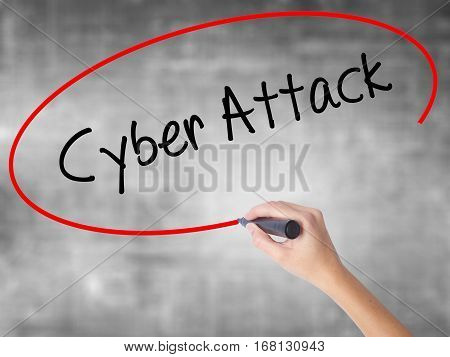 Woman Hand Writing Cyber Attack With Black Marker Over Transparent Board