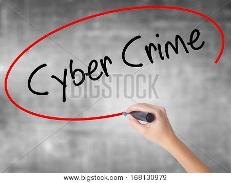 Woman Hand Writing Cyber Crime With Black Marker Over Transparent Board