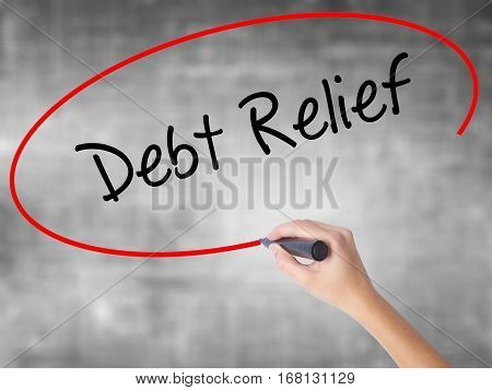 Woman Hand Writing Debt Relief With Black Marker Over Transparent Board