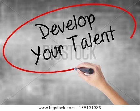 Woman Hand Writing Develop Your Talent With Black Marker Over Transparent Board.
