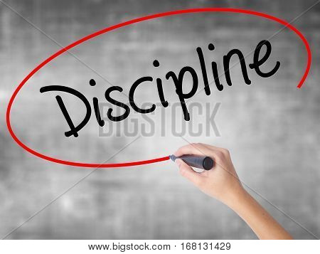 Woman Hand Writing Discipline With Black Marker Over Transparent Board