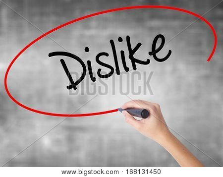 Woman Hand Writing Dislike  With Black Marker Over Transparent Board