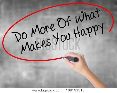 Woman Hand Writing Do More Of What Makes You Happy With Black Marker Over Transparent Board