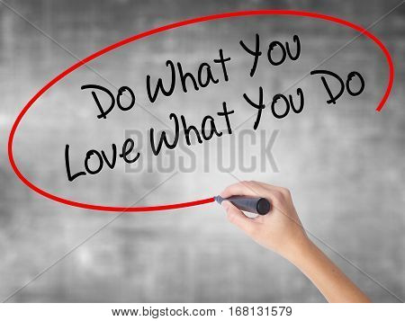 Woman Hand Writing Do What You Love What You Do With Black Marker Over Transparent Board