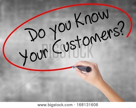 Woman Hand Writing Do You Know Your Customers? With Black Marker Over Transparent Board