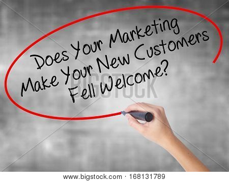 Woman Hand Writing Does Your Marketing Make Your New Customers Fell Welcome?  With Black Marker Over