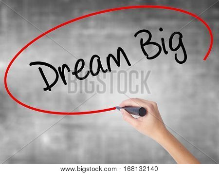 Woman Hand Writing Dream Big  With Black Marker Over Transparent Board