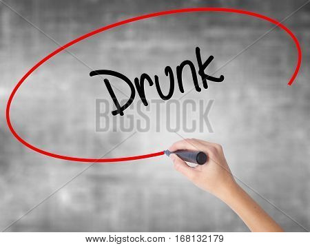 Woman Hand Writing Drunk With Black Marker Over Transparent Board