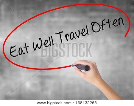Woman Hand Writing Eat Well Travel Often With Black Marker Over Transparent Board