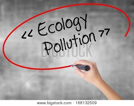 Woman Hand Writing Ecology - Pollution With Black Marker Over Transparent Board